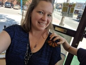 Kelly Farrell with monarch butterfly at oak learners