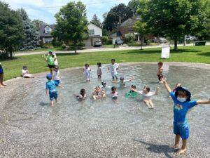 Summer Camp splash park with kids